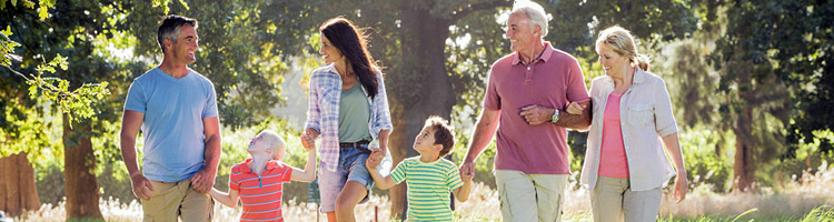 Family Controlled Trusts page - Multi-Generation Family Enjoying Walk in Beautiful Countryside