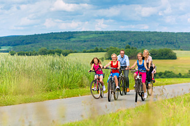 Investment Advice Case Study - Couple with three young children cycling