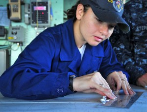 100310-N-4774B-112 ATLANTIC OCEAN (March 10, 2010) Quartermaster Seaman Apprentice Kimberly Ramirez, from Las Vegas, uses a slide rule to calculate chart measurements on the bridge of the guided-missile cruiser USS Bunker Hill (CG 52). Bunker Hill is underway off the coast of Argentina supporting Southern Seas 2010, a U.S. Naval Forces Southern Command Partnership of the Americas maritime engagement strategy to enhance regional stability and strengthen relationships among regional partners. (U.S. Navy photo by Mass Communication Specialist 2nd Class Daniel Barker/Released)