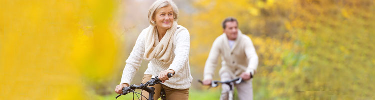 Active seniors riding bike - Pension Advisers Bristol