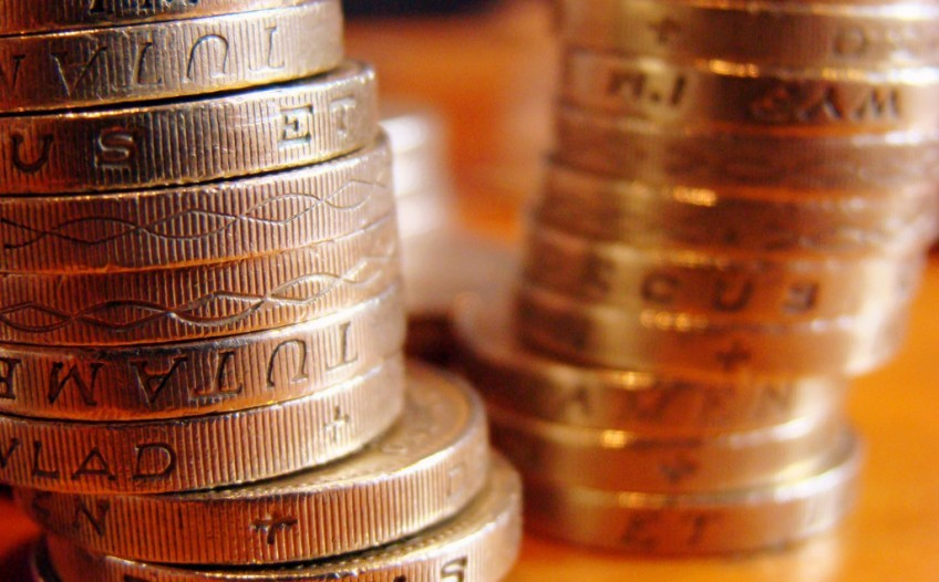 Pension money coins stacked