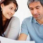 Pension advice - couple talking to pension transfer specialist